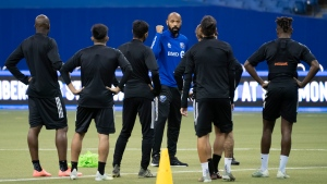 Players listen to Montreal Impact head coach Thierry Henry during a practice in Montreal on Wednesday, March 4, 2020. THE CANADIAN PRESS/Paul Chiasson