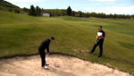 Hitting from a fairway bunker can be a challenge. Glenn Campbell gets a tip from Scott Orban.