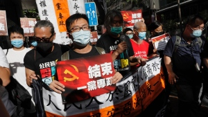 Pro-democracy protesters shout slogans 'Stop One Party Rolling' as they march toward the flag raising ceremony marking the anniversary of the Hong Kong handover to China, in Hong Kong Wednesday, July 1, 2020. (AP / Vincent Yu)