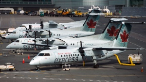 Air Canada planes sit on the tarmac at Pearson International Airport in Toronto on Wednesday, April 8, 2020. THE CANADIAN PRESS/Nathan Denette