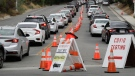 Motorists line up at a coronavirus testing site at Dodger Stadium Monday, June 29, 2020, in Los Angeles. (AP / Marcio Jose Sanchez)