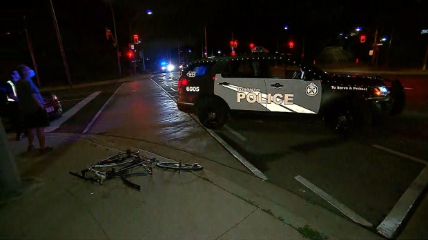 A bike lies in the road at at Colborne Lodge Drive and The Queensway after a cyclist was struck by a vehicle Tuesday June 30, 2020.