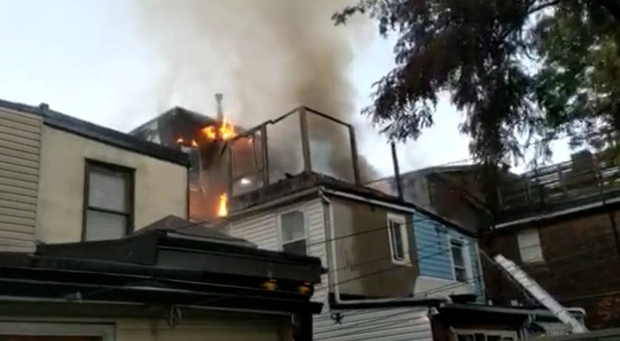 Flames are seen coming from a residence on Major Street on Wednesday morning. (Submitted)