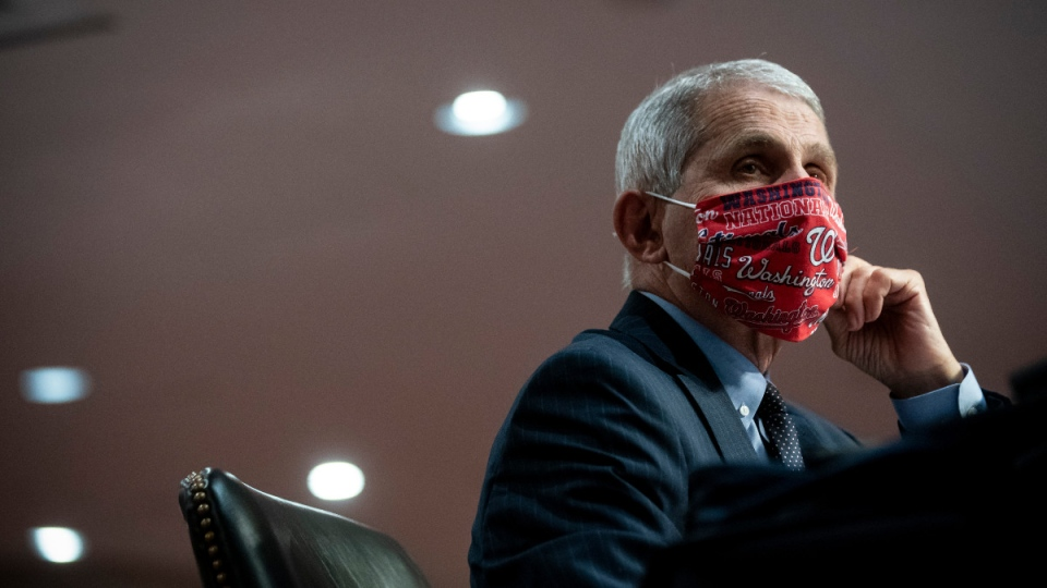 Dr. Anthony Fauci wears a face covering