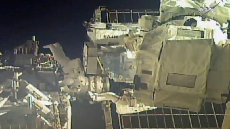 In this image taken from NASA video, commander Chris Cassidy, right, and NASA astronaut Bob Behnken perform their second spacewalk in under a week, on July 1, 2020. (NASA via AP)