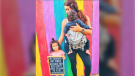 "Rios has since spoken out about the alleged experience in a viral Instagram post, which features her daughter holding a sign that reads, ""My mommy got fired because her boss didn't want to hear me in the background."" (ModernCaliMom/Instagram)"