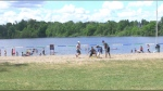 Dozens of people packed Mooney's Bay at 12 p.m. on Canada Day. (Saron Fanel/CTV News Ottawa)