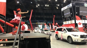 """PNE visitors drive past an entertainer for the Canada Day """"reverse parade"""" on Wednesday, July 1, 2020."""
