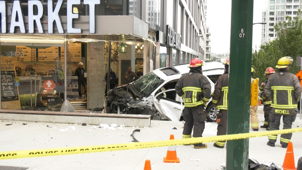 Firefighters and police respond after an SUV crashed into a Fresh St. Market in downtown Vancouver on July 1, 2020.