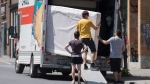People load a truck with belongings as they move on Canada Day in Montreal, Wednesday, July 1 2020, as the COVID-19 pandemic continues in Canada and around the world. THE CANADIAN PRESS/Graham Hughes