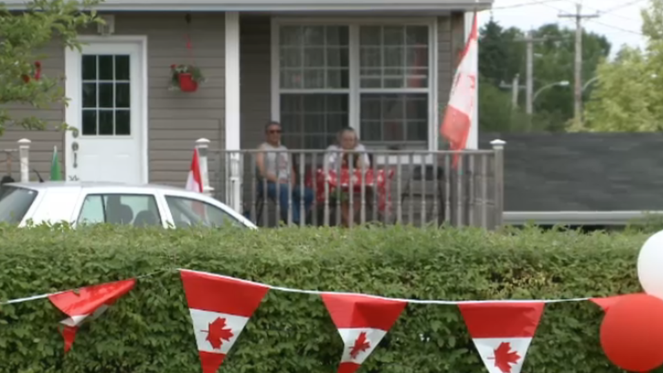 Gary and Beverly Maroun sit on porch on Canada Day