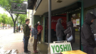 Customers line up at newly opened Yoshii Express on Whyte Avenue on July 1, 2020.
