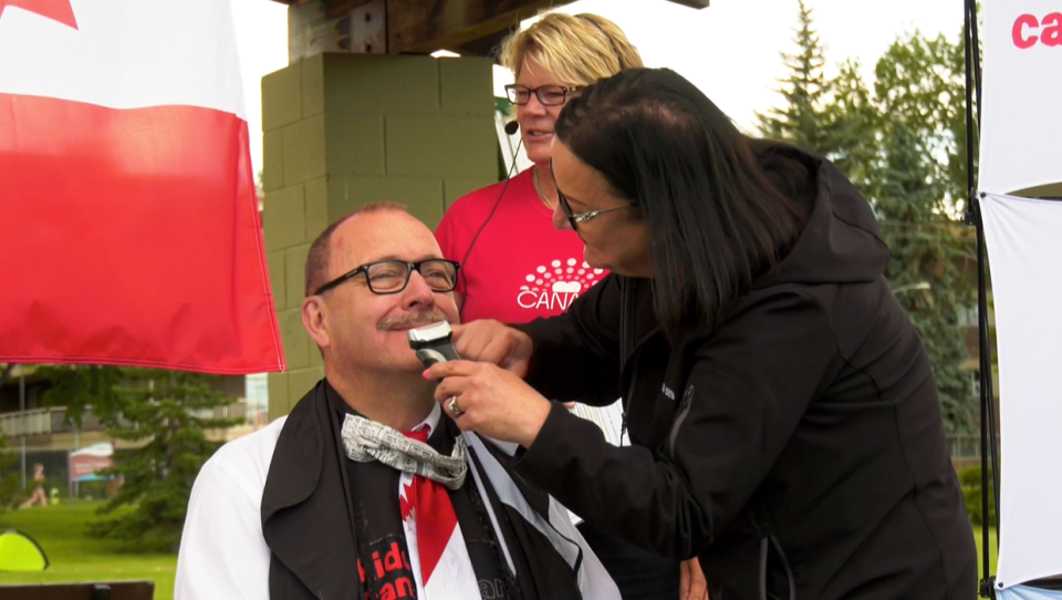 Alberta MLA Ric McIver cut off his moustache, which he had been cultivating since the mid-1970's, Wednesday in a fundraiser for the Kids Cancer Care Foundation of Alberta.