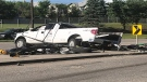 Witnesses say this white truck rolled over when it was struck by another vehicle in a collision early Wednesday evening