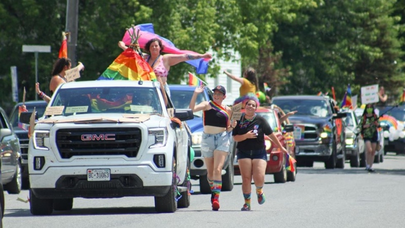 """After the local town council of Emo, Ont., struck down a resolution honouring June as Pride month, a local Pride group threw a Pride """"ambush"""" anyway, featuring more than 70 cars and hundreds of attendees. (Ken Kellar/ Fort Frances Times)"""