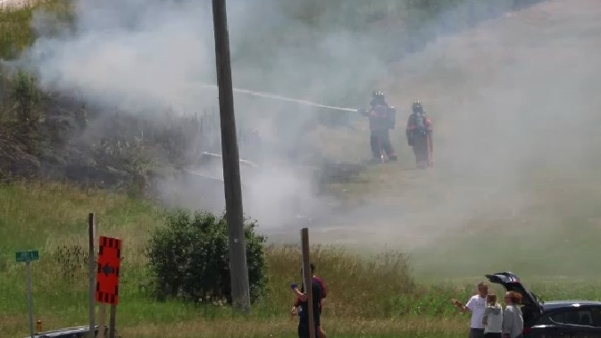 Firefighters at the scene of a crash on Highway 6 near Fergus. (July 1, 2020)