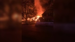 Flames are seen coming from a house fire on Colborne Street in Markham on Thursday morning.