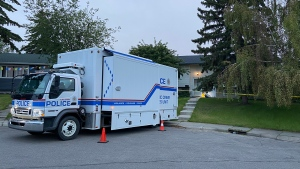 A CPS forensic crimes scene unit outside of a home on Margate Cl. N.E. on July 2, 2020 during the investigation into a June 30 death.