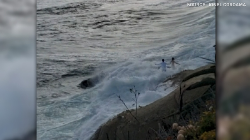 A bride and groom's wedding photoshoot took a dramatic turn after a large wave swept them into the Pacific Ocean.