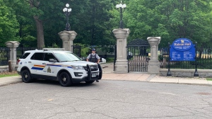 RCMP at the gate to Rideau Hall in Ottawa, after an armed man accessed the grounds July 2, 2020. Debris can be seen near the gate. (Marley Parker / CTV News)