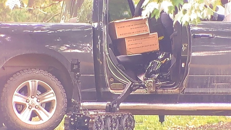 A police robot is seen investigating a truck on the grounds of Rideau Hall, after RCMP said an armed man accessed the grounds early July 2, 2020. (Marley Parker / CTV News)