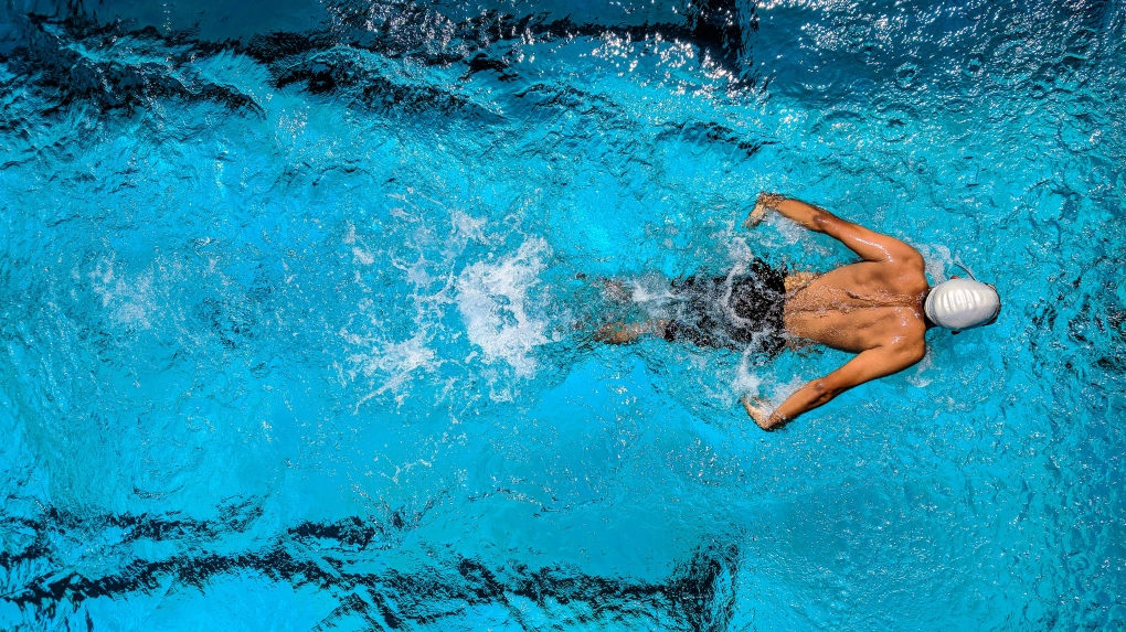 A swimmer in a pool lane from above