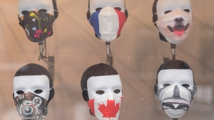 Face masks are shown in the window of a store in Montreal. THE CANADIAN PRESS/Graham Hughes