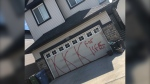 Graffiti on the door of an attached garage in the northeast Calgary neighbourhood of Skyview Ranch on June 19, 2020 (supplied)