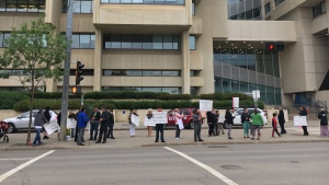 Wade Stene's court appearance was delayed until the end of the month following a protest outside the law courts on Thursday, July 2, 2020. (Evan Klippenstein/CTV News Edmonton)