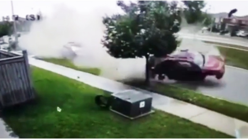 The moment a car flipped down a Brampton, Ont. residential street was caught on camera. (Instagram / @ramis.ca)