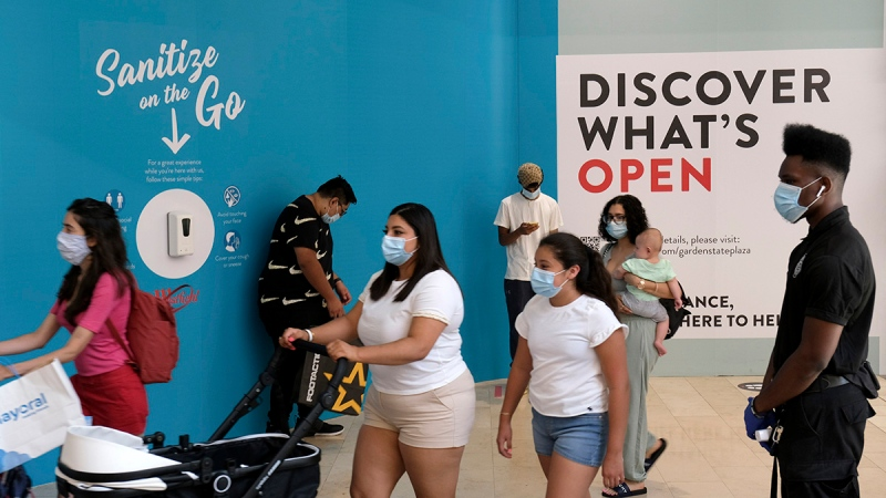 Shoppers walk around Garden State Plaza in Paramus, N.J., as New Jersey's indoor shopping malls reopened Monday from their COVID-19 pause. June 29, 2020. (AP Photo/Seth Wenig, File)