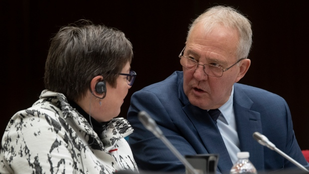 Public Safety and Emergency Preparedness Minister Bill Blair speaks with RCMP Commissioner Brenda Lucki as they wait to appear before the Standing Committee on Public Safety and National Security Thursday, February 27, 2020 in Ottawa. THE CANADIAN PRESS/Adrian Wyld