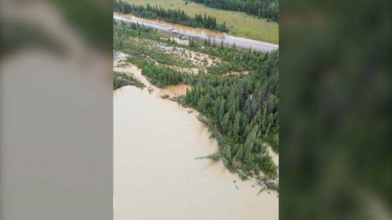 Highway 16 east of the Jasper townsite was flooded and closed July 2, 2020. Park officials said rivers and streams in the area were already high before another 50 millimetres of rain in two days. (Credit: Landon Shepherd, Parks Canada)