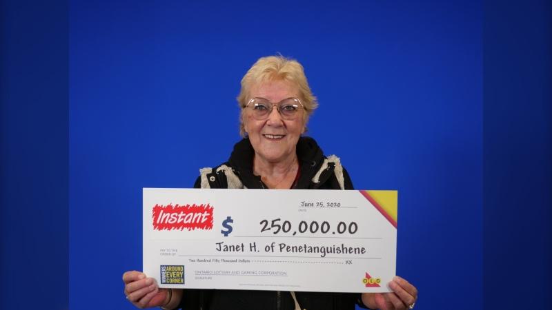 Janet Hembruff of Penetanguishene holds her winning OLG Lottery ticket in Toronto, Ont. (Supplied)
