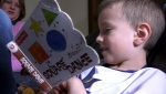 Six-year-old Oliver Oxton reads a story to his mom Brittany. The youngster has speech issues and has been supported through special programming through Alberta Health Services.