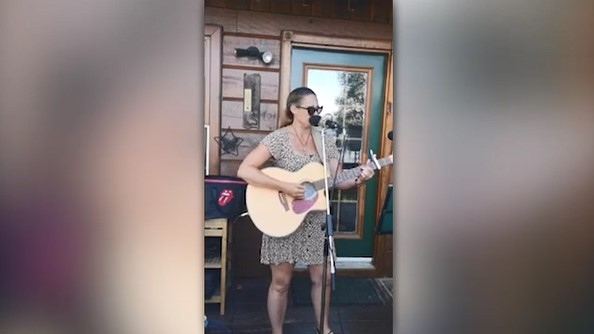 "Tonight's song is by Patty Crozier, singing an original called ""In The Blink of My Eye"" from a front porch concert in the South River area."
