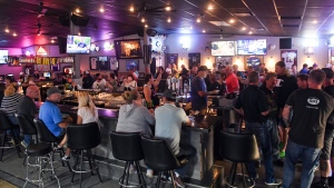 In this Thursday, June 18, 2020, file photo, patrons fill the Crow Bar in Sioux Falls, S.D. (Erin Bormett/The Argus Leader via AP, File)
