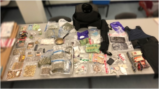 A large quantity of cash, drugs, guns and bullets were seized by Peel Regional Police during on Canada Day. (Supplied)