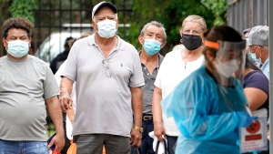 People wait in line at a free COVID-19 testing site provided by United Memorial Medical Center, at the Mexican Consulate, Sunday, June 28, 2020, in Houston. Confirmed cases of the coronavirus in Texas continue to surge. (AP / David J. Phillip)