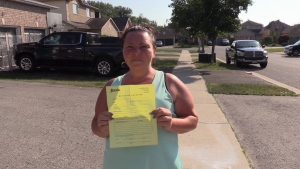 Erin Van Kessel displays by-law violation outside her north-end Barrie home July 2, 2020.