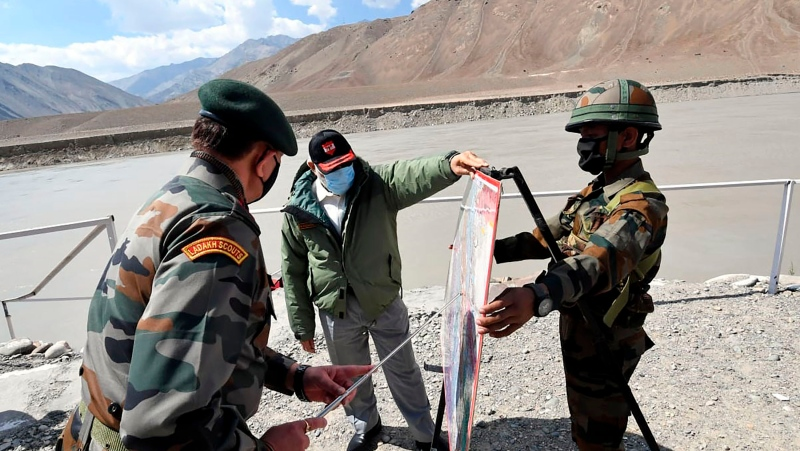 In this handout photo provided by the Press Information Bureau, Indian Prime Minister Narendra Modi interacts with soldiers during a visit to the Ladakh area, India, Friday, July 3, 2020. (Press Information Bureau via AP)