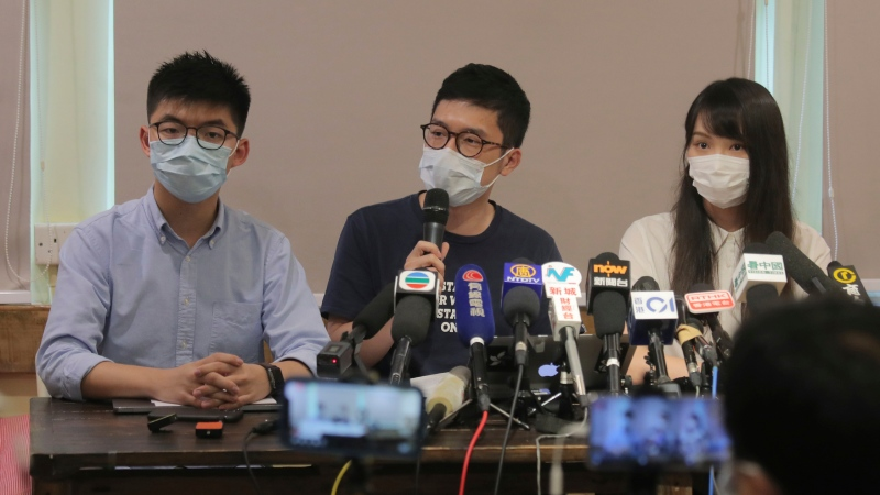 Pro-democracy activists, from left; Joshua Wong, Nathan Law, and Agnes Chow attend a press conference in Hong Kong, Saturday, May 30, 2020. (AP Photo/Kin Cheung)