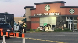 Three people are dead after this Audi crashed into the Starbucks on Calgary Trail and 55 Avenue on Friday, July 3, 2020. (Evan Klippenstein/CTV News Edmonton)