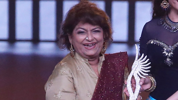In this Sept. 19, 2019, file photo, Indian choreographer Saroj Khan is presented a special award during the 20th International Indian Film Academy (IIFA) awards ceremony in Mumbai, India. (AP Photo/Rafiq Maqbool, File)