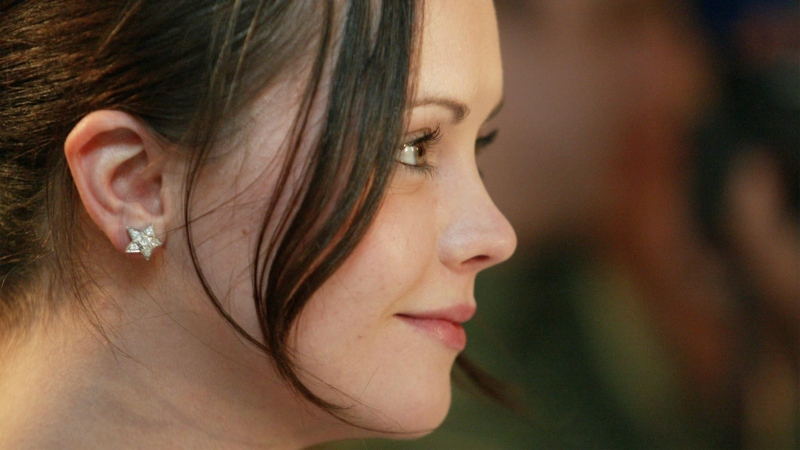 Christina Ricci listens to a question at a news conference in Toronto on Saturday, Sept. 6, 2003 for the film I Love Your Work at the Toronto International Film Festival. (CP PHOTO/Tobin Grimshaw)