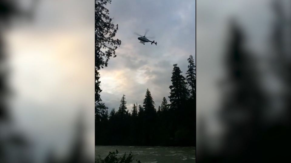A helicopter searches overhead for a man believed to be missing in the Coquihalla River on July 2, 2020. (Submitted)