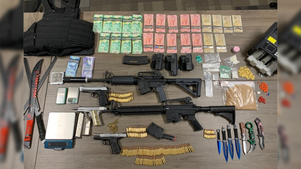 Drugs, weapons and cash seized in St. Thomas, Ont. on Thursday, July 2, 2020 are seen in this image released by the St. Thomas Police Service.