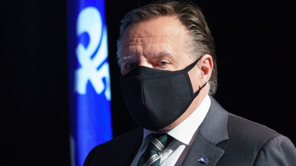 Quebec Premier Francois Legault arrives at a news conference in Montreal, Tuesday, June 30, 2020. THE CANADIAN PRESS/Paul Chiasson