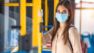 COVID-19: Face mask on transit bus