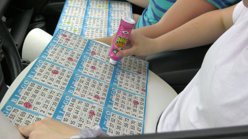 Avid bingo players dab their cards on their laps as they play drive-in bingo in Cornwall, Ont. Winners honk the horn when they get a bingo. (Nate Vandermeer / CTV News Ottawa)
